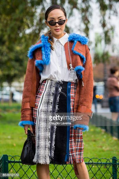Chriselle Lim is seen wearing an Off White coat and Sonia Rykiel skirt before the Maison Margiela show at the Grand Palais during paris Fashion week...