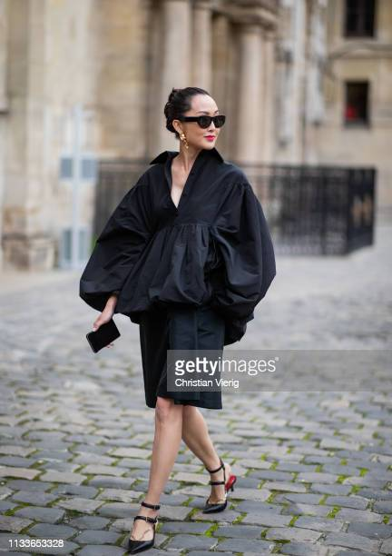 Chriselle Lim is seen wearing black dress outside Thom Browne during Paris Fashion Week Womenswear Fall/Winter 2019/2020 on March 03 2019 in Paris...