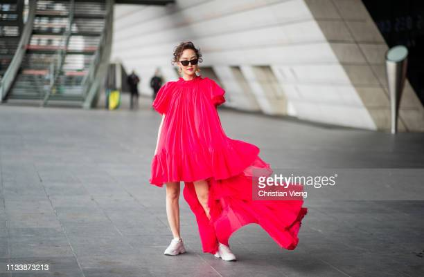 Chriselle Lim is seen wearing red dress outside Giambattista Valli during Paris Fashion Week Womenswear Fall/Winter 2019/2020 on March 04, 2019 in...