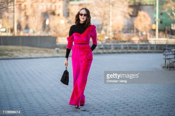 Chriselle Lim is seen wearing velvet pants and top outside Self-Portrait during New York Fashion Week Autumn Winter 2019 on February 09, 2019 in New...