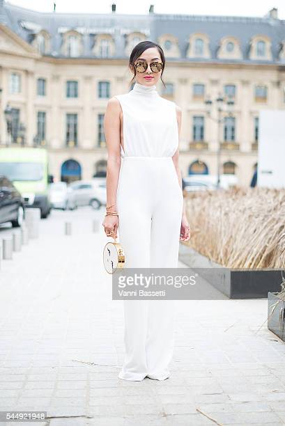 Chriselle Lim poses wearing a Misha Collection dress before the Schiaparelli show in Place Vendome during Paris Fashion Week Haute Couture FW 16/17...