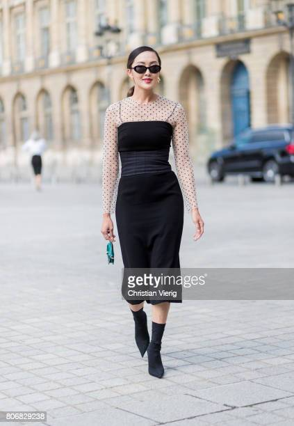 Chriselle Lim wearing a black dress black boots outside Schiaparelli during Paris Fashion Week Haute Couture Fall/Winter 20172018 Day Two on July 3...