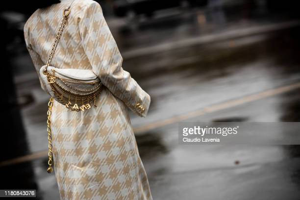 Chriselle Lim wearing a cream coat gold belt and Chanel bag is seen outside the Chanel show during Paris Fashion Week Womenswear Spring Summer 2020...