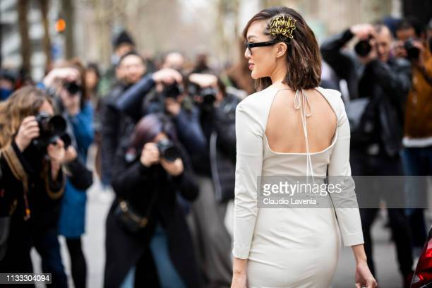 Chriselle Lim wearing a cream dress and cream bag is seen outside Altuzarra on Day 6 Paris Fashion Week Autumn/Winter 2019/20 on March 2 2019 in...