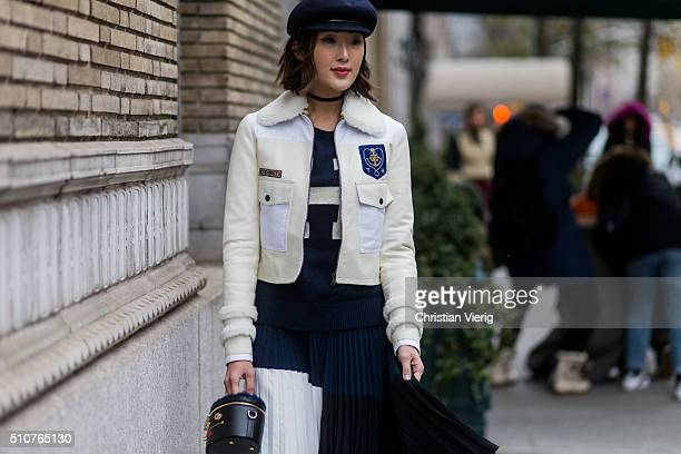 Chriselle Lim wearing a creme Tommy Hilfiger jacket and skirt Ines Figaredo bag seen outside Tommy Hilfiger during New York Fashion Week Women's...