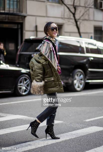 Chriselle Lim wearing a green parka outside Marc Jacobs on February 16 2017 in New York City