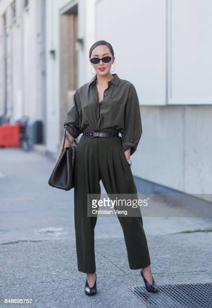 Chriselle Lim wearing an overall seen in the streets of Manhattan outside Michael Kors during New York Fashion Week on September 13 2017 in New York...