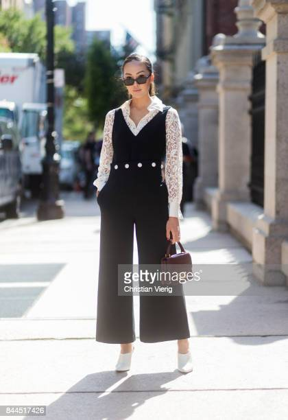 Chriselle Lim wearing black overall seen in the streets of Manhattan outside Tory Burch during New York Fashion Week on September 8 2017 in New York...