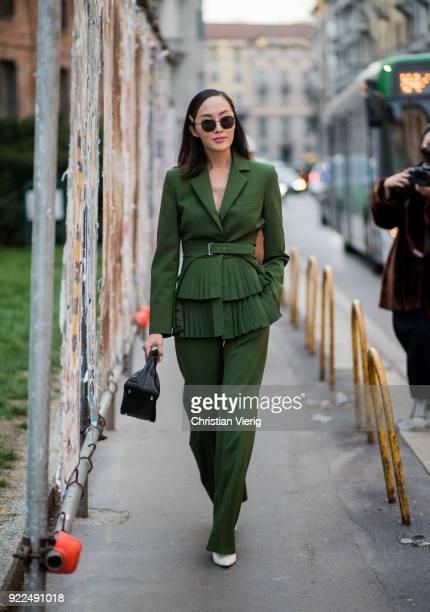 Chriselle Lim wearing green suit seen outside Alberta Ferretti during Milan Fashion Week Fall/Winter 2018/19 on February 21 2018 in Milan Italy