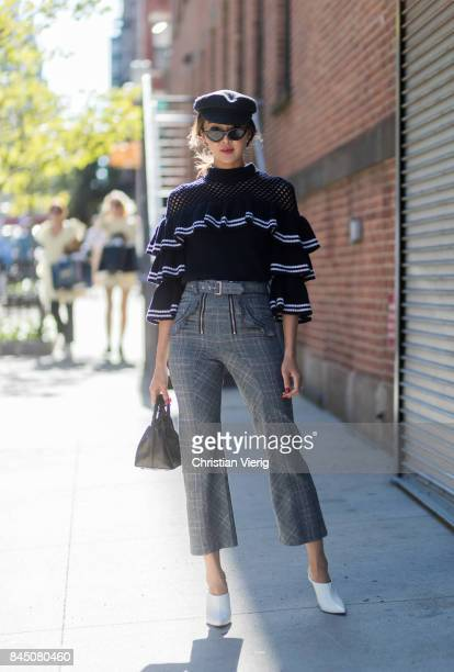 Chriselle Lim wearing grey cropped pants knit flat cap seen in the streets of Manhattan outside SelfPortrait during New York Fashion Week on...