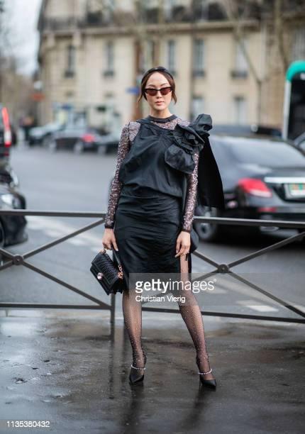 Chriselle Lim wearing ruffled dress sheer tights outside Miu Miu during Paris Fashion Week Womenswear Fall/Winter 2019/2020 on March 05 2019 in Paris...