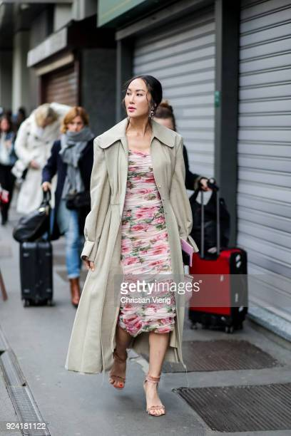 Chriselle Lim wearing trench coat and dress is seen outside Dolce Gabbana during Milan Fashion Week Fall/Winter 2018/19 on February 25 2018 in Milan...