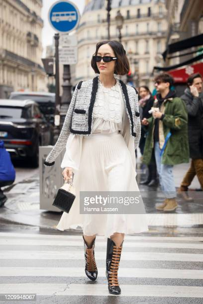 Chriselle Lim wearing tweed jacket, white lace blouse, white flare midi skirt and black patent boots outside Giambattista Valli during Paris Fashion...