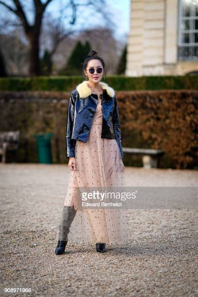 Chriselle Lim wears a black jacke a lace dress after Dior during Haute Couture Spring/Summer 2018 on January 22 2018 in Paris France