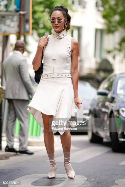 Chriselle Lim wears a white dress outside the Elie Saab show during Paris Fashion Week Haute Couture Fall/Winter 20172018 on July 5 2017 in Paris...