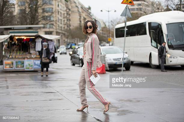 Chriselle Lim wears an Elie Saab tracksuit at the Elie Saab Couture show at Trocadero on January 27 2016 in Paris France