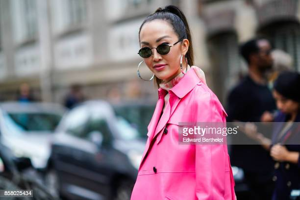 Chriselle Lim wears sunglasses and a pink jacket outside Valentino during Paris Fashion Week Womenswear Spring/Summer 2018 on October 1 2017 in Paris...