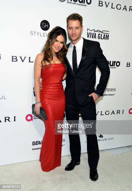 Chrishelle Stause and Justin Hartley attend the 25th Annual Elton John AIDS Foundation's Academy Awards Viewing Party at The City of West Hollywood...