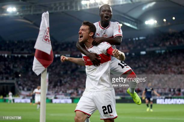 Chrisitan Gentner of VfB Stuttgart celebrates after scoring his team's first goal with Chadrac Akolo of VfB Stuttgart during the Bundesliga playoff...