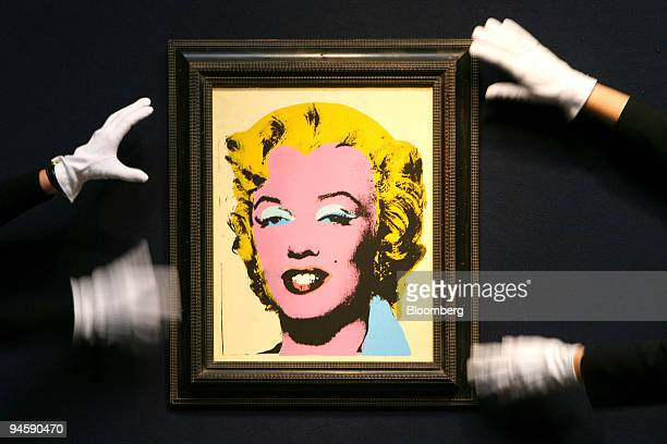 Chrisites employees straighten ''Lemon Marilyn'' by Andy Warhol from 1962 at Christies in London UK Monday March 19 2007 The painting is up for sale...