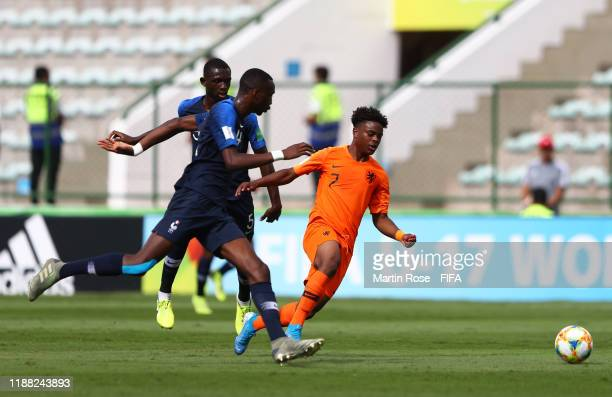 Chrislain Matsima of France is tackled by Sontje Hansen of Netherlands during the 3rd Place Playoff match between the Netherlands and France at the...
