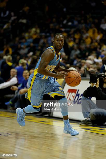 Chrisoher Hyder of the Southern Jaguars dribbles the basketball around the perimeter during the game against the Marquette Golden Eagles at BMO...