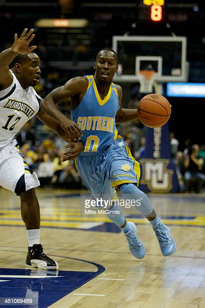 Chrisoher Hyder of the Southern Jaguars drives into the lane during the game against the Marquette Golden Eagles at BMO Harris Bradley Center on...