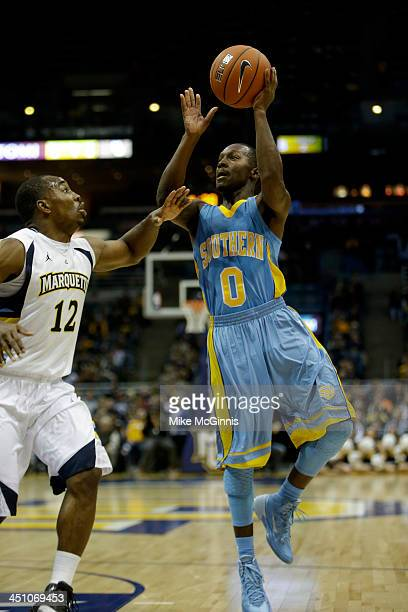 Chrisoher Hyder of the Southern Jaguars drives to the hoop during the game against the Marquette Golden Eagles at BMO Harris Bradley Center on...