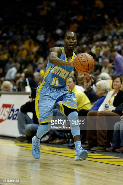 Chrisoher Hyder of the Southern Jaguars passes the basketball during the game against the Marquette Golden Eagles at BMO Harris Bradley Center on...