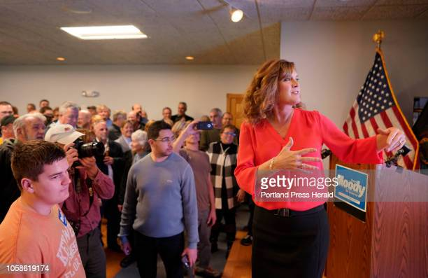 Chrissi Moody wife of gubernatorial candidate Shawn Moody gestures to a screen that will show voting results while talking to Moody supporters on...