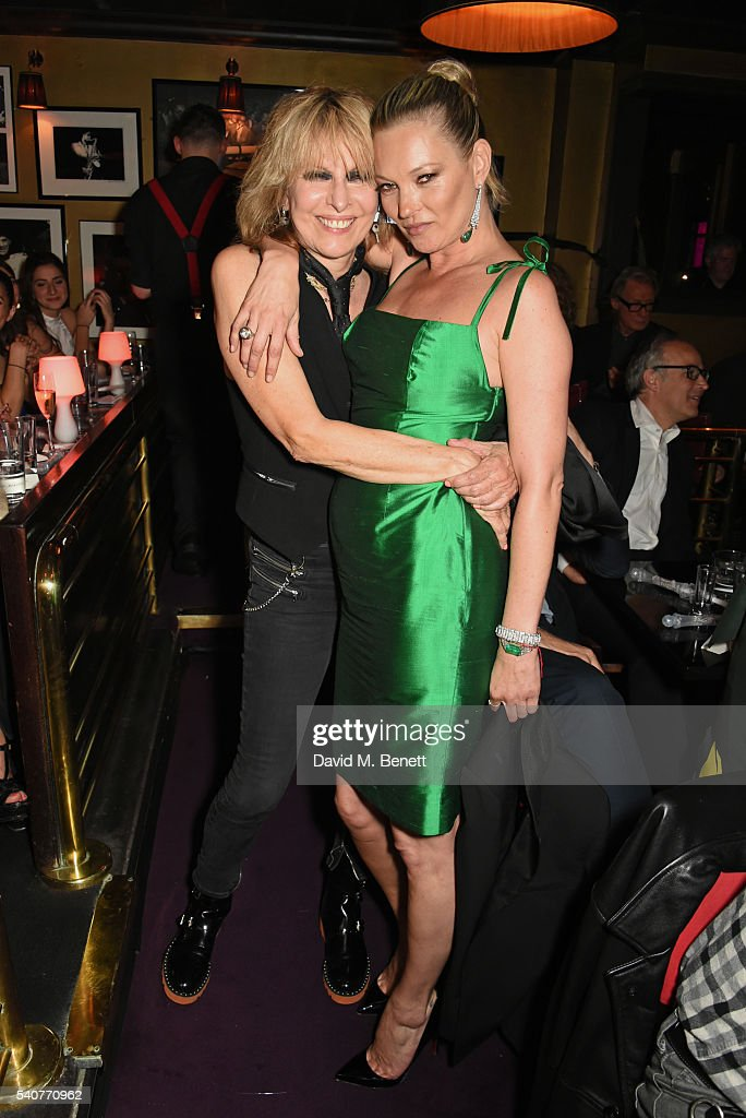 Chrissie Hynde (L) and Kate Moss pose following their performance of 'Stand By Your Man' at 'Hoping's Greatest Hits', the 10th anniversary of The Hoping Foundation's fundraising event for Palestinian refugee children hosted by Bella Freud and Karma Nabulsi, at Ronnie Scott's on June 16, 2016 in London, England.