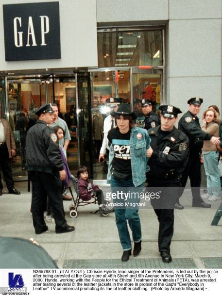 Chrissie Hynde lead singer of the Pretenders is led out by the police after being arrested at the Gap store at 48th Street and 6th Avenue in New York...