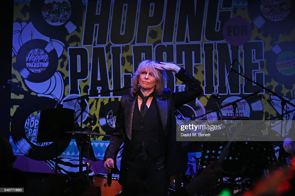 Chrissie Hynde (C) performs at 'Hoping's Greatest Hits', the 10th anniversary of The Hoping Foundation's fundraising event for Palestinian refugee children hosted by Bella Freud and Karma Nabulsi, at Ronnie Scott's on June 16, 2016 in London, England.