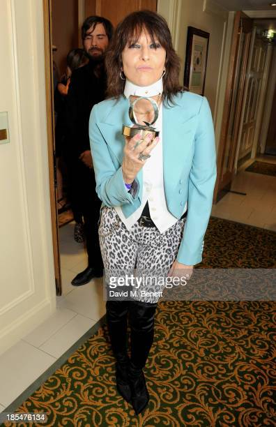 Chrissie Hynde winner of the Classic Songwriter award poses in the press room at The Q Awards at The Grosvenor House Hotel on October 21 2013 in...