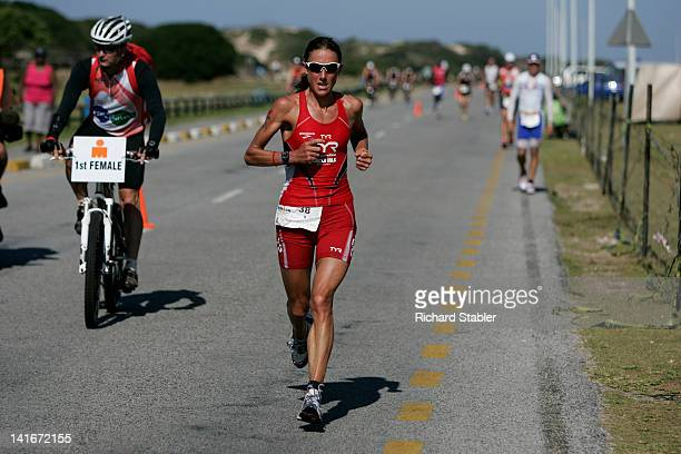 Chrissie Wellington running toward her new Ironman World Record during Ironman South Africa 2011. Port Elizabeth, South Africa.