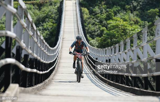 Chrissy Conyers of Australia competes in the Hero MTB Himalaya mountain bike race near Mandi in the northern Indian state of Himachal Pradesh on...