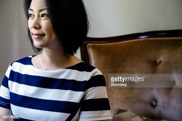 Chrissy Luo cofounder and vice chairman of Shanda Group poses for a photograph in Singapore on Friday June 9 2017 A dozen years ago the largest...