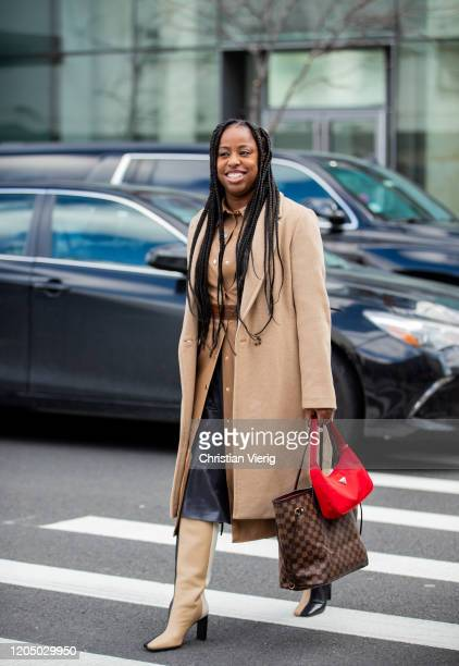 Chrissy Rutherford is seen wearing beige coat red Prada bag outside SelfPortrait during New York Fashion Week Fall/Winter 20 on February 08 2020 in...