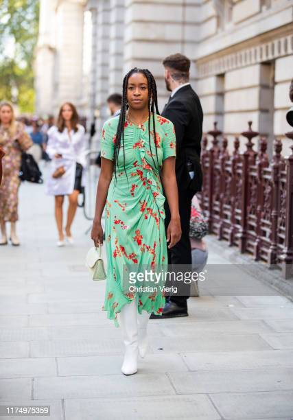 Chrissy Rutherford is seen wearing green dress, white boots outside Victoria Beckham during London Fashion Week September 2019 on September 15, 2019...