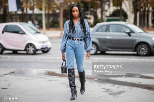 Chrissy Rutherford wearing denim jeans, button shirt, black overknees boots is seen outside Chanel during Paris Fashion Week Womenswear Spring/Summer...