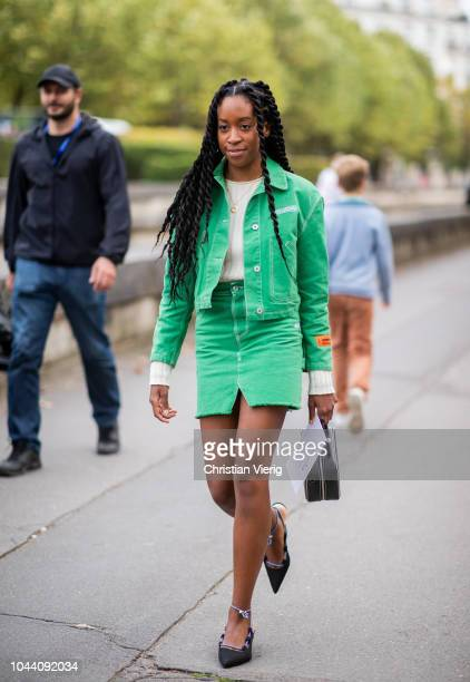 Chrissy Rutherford wearing green button jacket mini skirt is seen outside Valentino during Paris Fashion Week Womenswear Spring/Summer 2019 on...