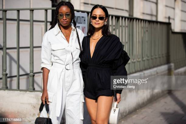 Chrissy Rutherford wearing white overall and Anna Rosa Vitiello is seen wearing black overall, white bag, outside Toga during London Fashion Week...