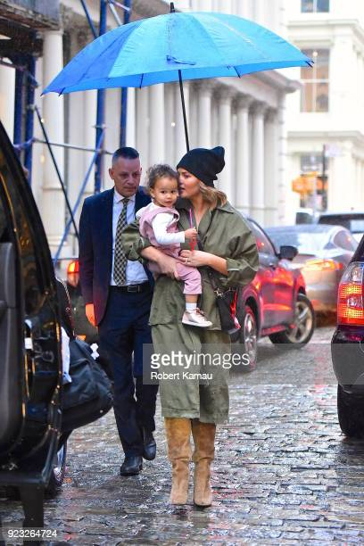 Chrissy Teigen and and her baby Luna Legend seen out and about on a rainy day in Manhattan on February 22 2018 in New York City