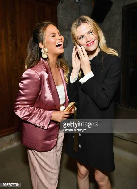 Chrissy Teigen and Finery CoFounder Brooklyn Decker attend the Finery App launch party hosted by Brooklyn Decker at Microsoft Lounge on July 11 2018...