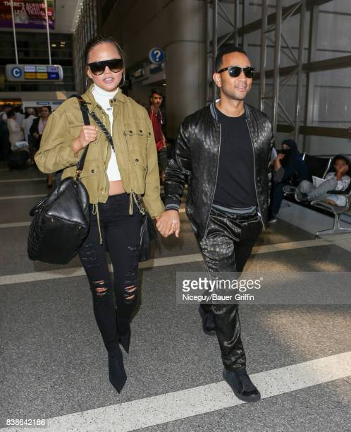 Chrissy Teigen and John Legend are seen at LAX on August 24 2017 in Los Angeles California