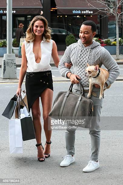 Chrissy Teigen and John Legend are seen in New York City on December 01 2014 in New York City