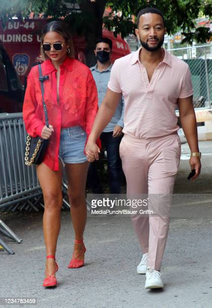 Chrissy Teigen and John Legend are seen on August 20, 2021 in New York City.