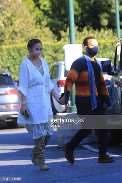 Chrissy Teigen and John Legend are seen on February 12, 2021 in Los Angeles, California.
