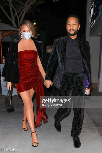 Chrissy Teigen and John Legend are seen on March 14, 2021 in Los Angeles, California.