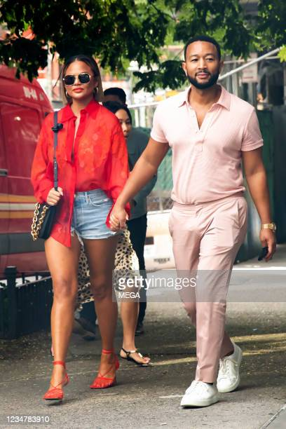 Chrissy Teigen and John Legend are seen out and about on August 20, 2021 in New York City, New York.